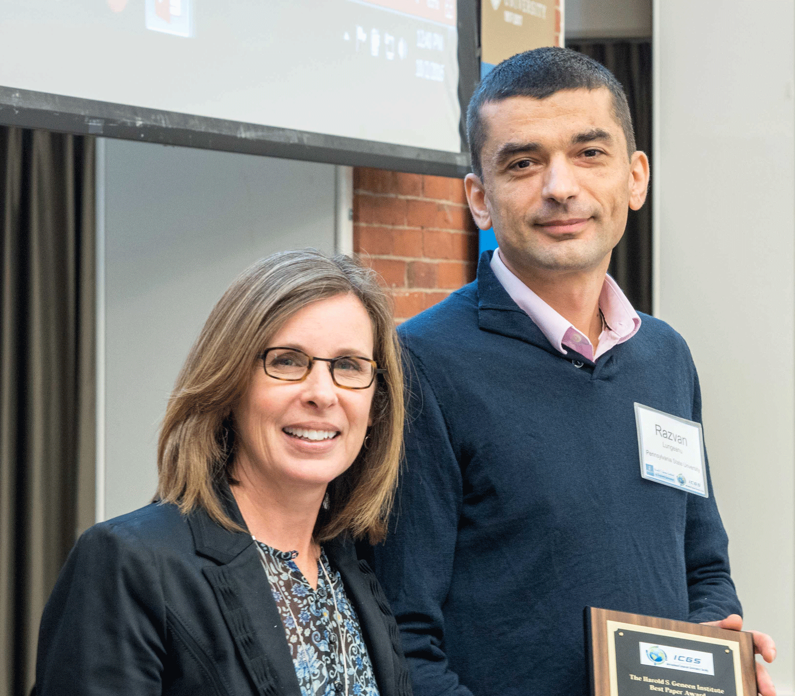 Conference Chair Cynthia Clark with Best Paper Awardee Razvan Lungeanu